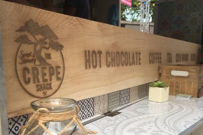 oak sign for The Crepe Shack