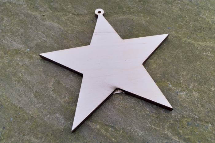 laser cut star with knot