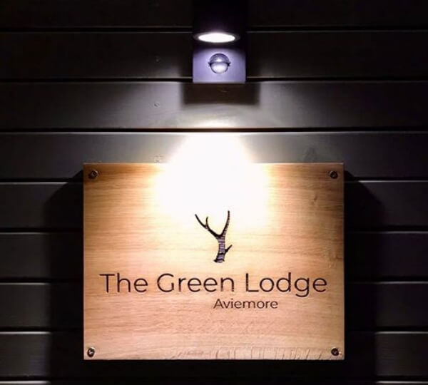 The Green Lodge Aviemore sign lit up
