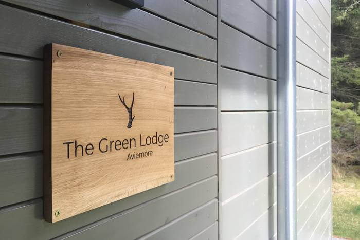 Oak signs for The Green Lodge Aviemore